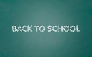 Back to school written on a chalk board.