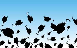 Graduation caps in the air.