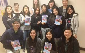La Quinta students displaying their newly released book.