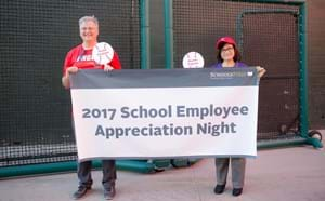 Two GGUSD member hold up 2017 School Employee Appreciation Night Banner at Angels Stadium.