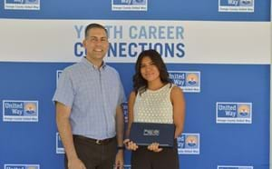 Student receiving recognition from 21st Century representative.