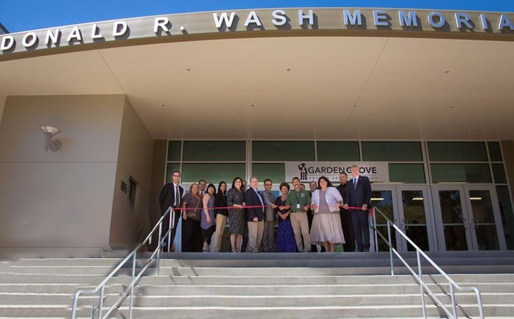 GGUSD board members and administrators at the ribbon cutting of the updated Donald R. Wash Memorial Auditorium.