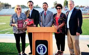Board members and Monsoor family receiving new stadium recognition on the new stadium turf.