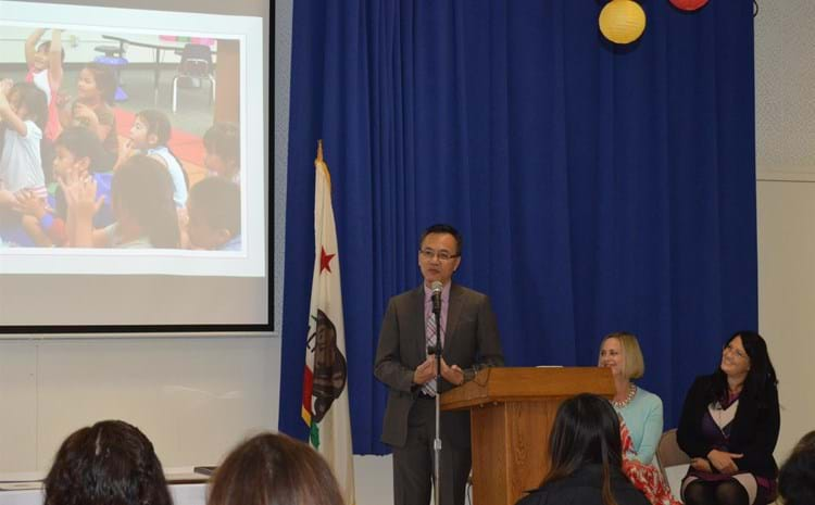 Board member giving a speech to celebrate new Vietnamese dual language program.