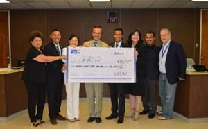 Board members receiving check.