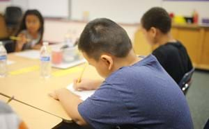 Young student in a classroom working on an assignment.