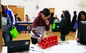 Student using a robotic creation at career fair.