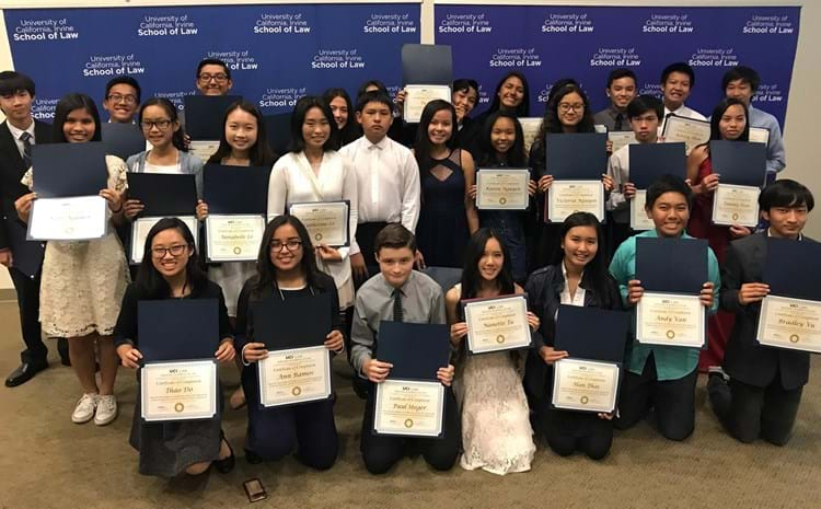 Several Bolsa Grande displaying participant award from a six-week law school experience.