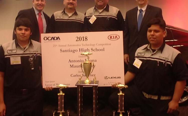 Santiago students, teachers and OCADA members display championship trophies.