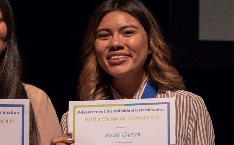 Avid student displaying her award.
