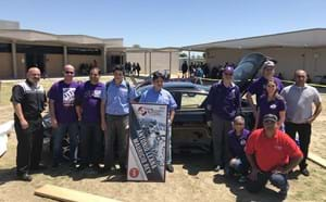 Santiago students, teachers and administrators after winning an automotive competition.