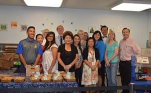 Members of the school district promote free meals for summer.