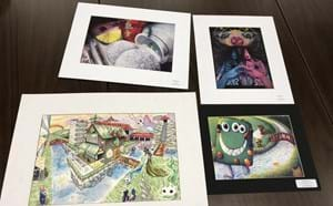 4 pieces of artwork from students.