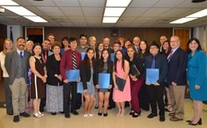 Members of the board of education and administrators of the district honor the valedictorians and salutatorians of class of 2018.
