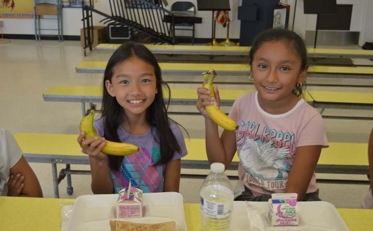Cook Elementary School students enjoy nutritious snacks at lunch. Low
