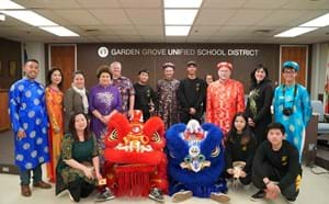 Lion dancers from Bolsa Grande High School pose for a picture with Superintendent Dr. Gabriela Mafi and Board of Education Members.