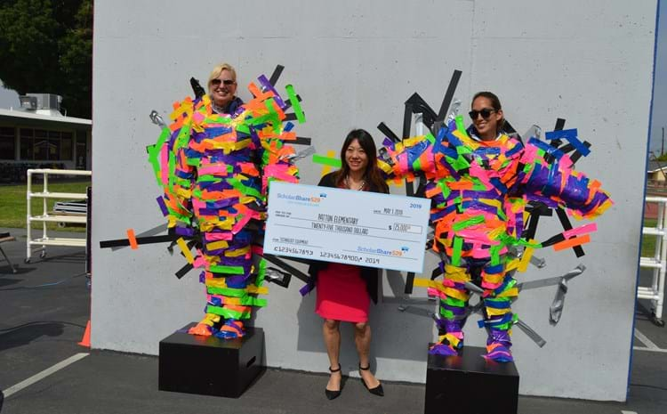 Patton Elementary School Principal Jennifer Carter, California State Treasuer Fiona Ma, and Patton Assistant Principal Julie Kawai pose for a photo after a school-wide assembly in which students duck-taped their principals to a wall as a prize for winning a $25,000 state grant for new technology.