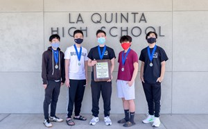 LQ students with championship plaque